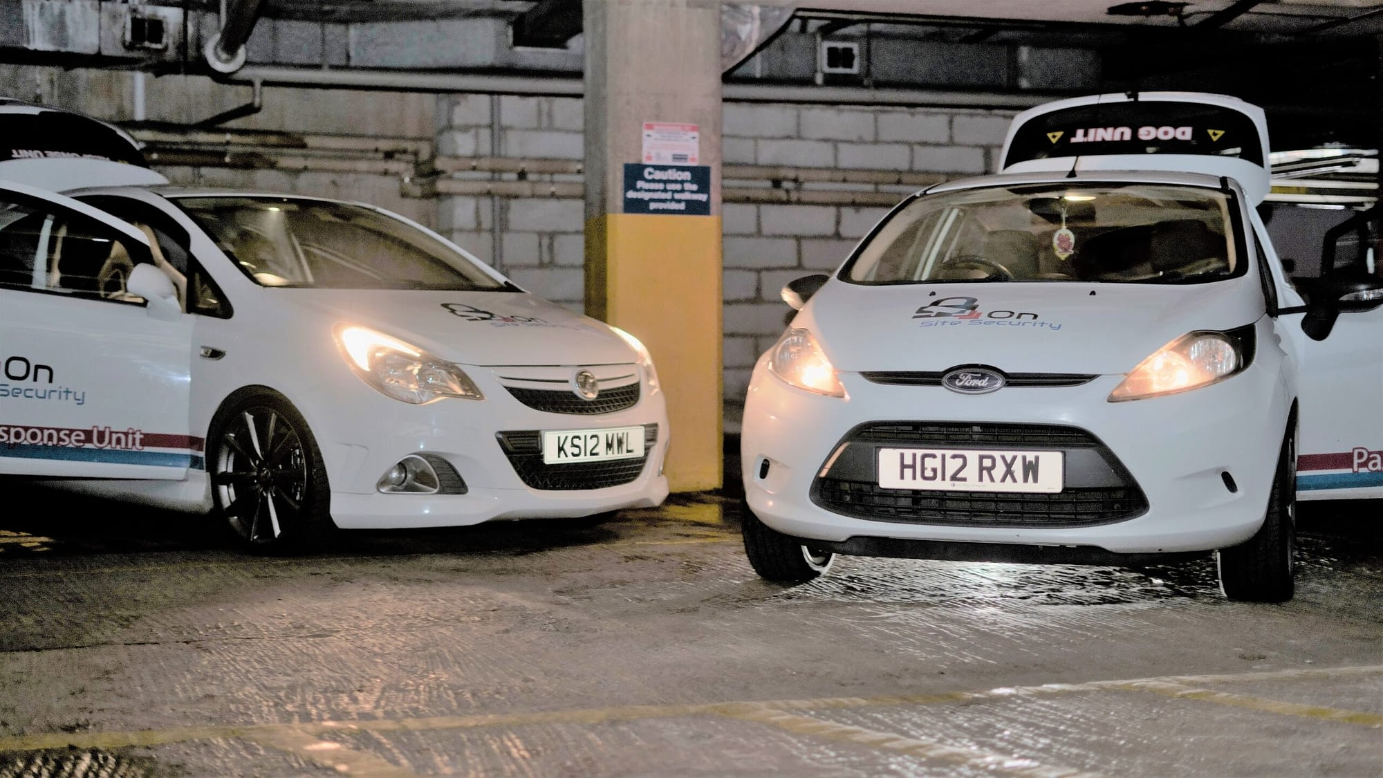 two security company cars in car park